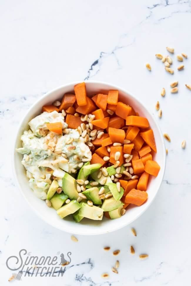 Sweet potato bowl with egg salad and avocado
